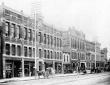 Victorian West Federal Street looking southwest toward Hazel Street. This image dates from 1889. The only remaining buildings include two circa 1870s commercial buildings belonging to First Educator's. The present-day streetscape includes the Kress Building, the 7th District Court of Appeals and First Educator's. Image courtesy of the Metro Monthly.