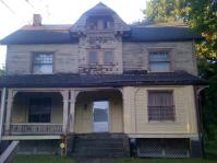 Arts-and-Crafts house on Illinois was undergoing repair and painting in 2012