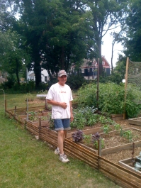 Bob Bartlett with his garden in the footprint of a former home on Baldwin