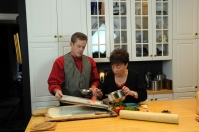 Mitch and Helga prepare a party item prior to baking.