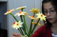Maddie works on an edible arrangement.