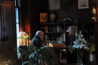 Jack Carlton and Paula Jasper in the library of he Garlick House.