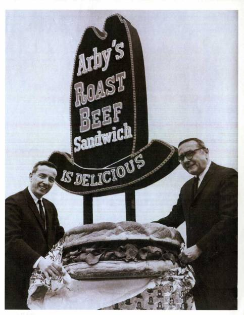 Leroy and Forrest Raffel in front of an original Arby's sign in the 1960s. Electronic image courtesy of the Mahoning Valley Historical Society.
