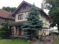 1890s chalet-style house gets primer coat