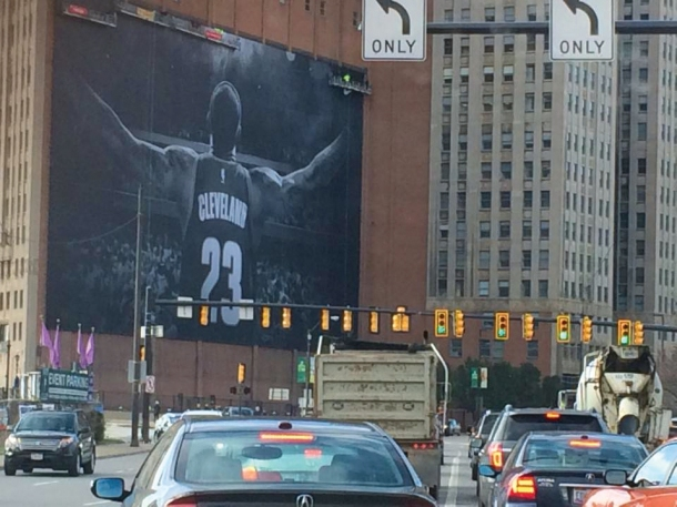 The commute into town was welcomed by LeBron James' outstretched arms on the newest Nike advertisement unfurled upon the Sherwin-Williams headquarters on the corner of W. Prospect